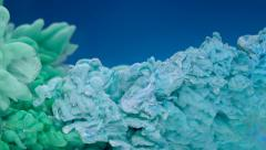 Dropping blue and green ink in water, Slow Motion Stock Footage