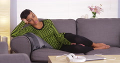 Attractive African woman sleeping on couch Stock Footage