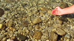 Purity - human hand taking pure water - stock footage