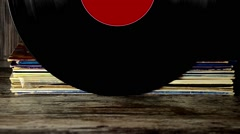 Various old vinyl records on the old wooden background Stock Footage