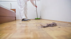 Sweeping floor dust with broom in slow motion - stock footage
