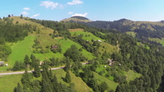 Harmony in mountains. Nature, village, beauty. Aerial shot - stock footage