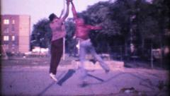 1196 - urban basketball game in the hood - vintage film home movie - stock footage