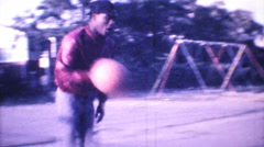 Black men play basketball in the hood 1195 vintage film home movie Stock Footage