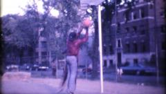 Black men one on one basketball in the hood 1197 vintage film home movie Stock Footage