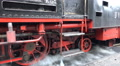 Classic steam locomotive wheels closeup pan in mountain forest station HD Footage