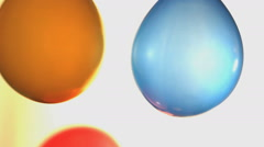 Dancing balloons on a white background - stock footage