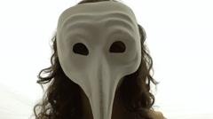 Vintage girl silhouette mask long nose CU LT Stock Footage