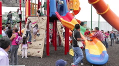 Children having fun in climbers and slides, mexican flag. FULL SHOT-HANDHELD. Stock Footage