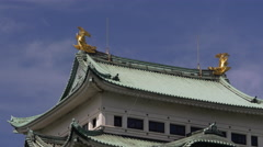 Kinshachi on Top of Nagoya Castle with Moving Clouds Stock Footage