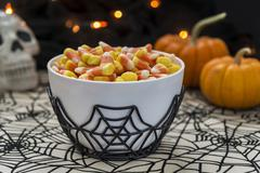 Candy corn in a Halloween theme - stock photo