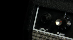 Male hand inserts jack in guitar amplifier Stock Footage