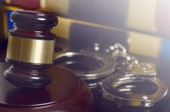 Law concept image - gavel and handcuffs Stock Photos