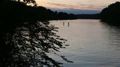 Paddle boarding at twilight time lapse Stock Footage