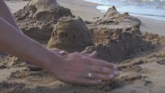 Builds sand castle - stock footage