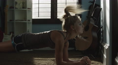 Medium shot of teenage girl doing planks in bedroom / Sandy, Utah, United States Stock Footage