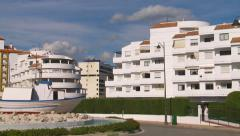 Fishing boat & apartment buildings, Estepona, Spain Stock Footage