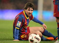 Messi of Barcelona fallen to the ground - stock photo
