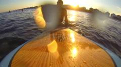 Vacationer surfs the Atlantic Ocean Stock Footage