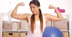 Strong Japanese woman showing off muscles - stock footage