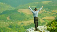 young businessman exults for realization of the success: achievement, glory, top - stock footage
