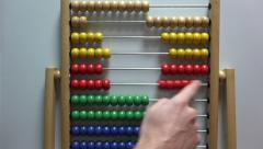 Movement of seed on the accounts of the abacus with your fingers - stock footage