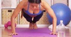 Japanese woman doing pushups Stock Footage