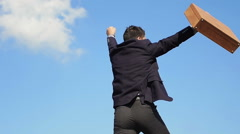 Young businessman conquest the success: climbing, win, reach, top, - stock footage