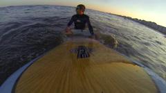 Man surfs in the Atlantic Ocean Stock Footage