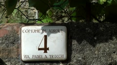 Europe Italy Liguria Airole village 010 house number on a stone wall Stock Footage