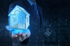 businessman hand shows house model - stock illustration