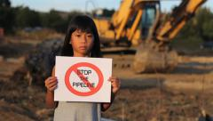 First Nations Girl With STOP THE PIPELINE Sign Stock Footage
