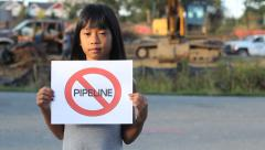 Little Girl Holding A NO PIPELINE Sign Stock Footage