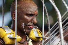 Hindu man wirh pierced chicks Stock Photos