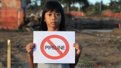 First Nations Girl With No Pipeline Sign Stock Footage