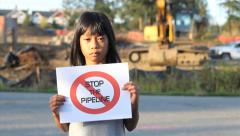 Girl Holding A Stop The Pipeline Sign Stock Footage