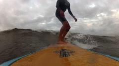 Surfer enjoying the warm waters of the Atlantic Ocean Stock Footage