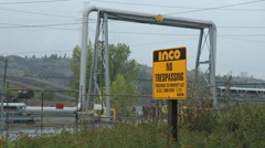 No trespassing sign at Inco facility. Sudbury, Ontario, Canada. Stock Footage