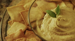 Panning close up high angle shot of pita chips and hummus / Cedar Hills, Utah, Stock Footage