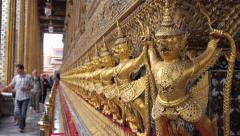 Tourists at Wat Phra Kaew, the Temple of the Emerald Buddha in Bangkok, Thailand Stock Footage