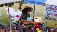 Thai Woman Cooking on Boat at Amphawa Floating Market, Bangkok, Thailand Stock Footage