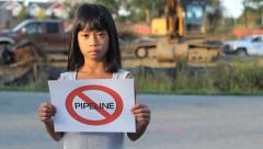 Little Girl Holds A NO PIPELINE Sign Stock Footage