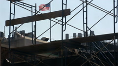 American Flag Construction Site Scaffolding Roof NYC Stock Footage