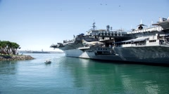 USS Midway docked at Navy Pier in downtown San Diego Stock Footage