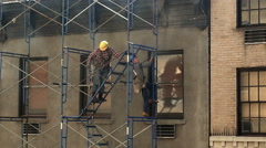 Construction Workers Hardhats Scaffolding Building NYC Union - stock footage
