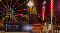 Medium shot of Ferris Wheel and amusement park at night / Salt Lake City, Utah, Stock Footage