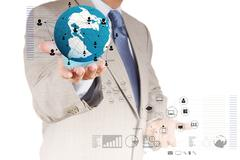 businessman hand holds the earth and social network diagram - stock illustration