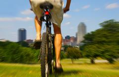 bike rider going fast in a city park - stock photo