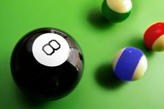 Assorted billiard balls, with macro 8 ball, from above Stock Photos