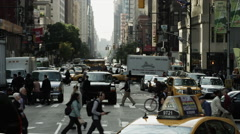 Wide shot of bustling city street / New York City, New York, United States - stock footage